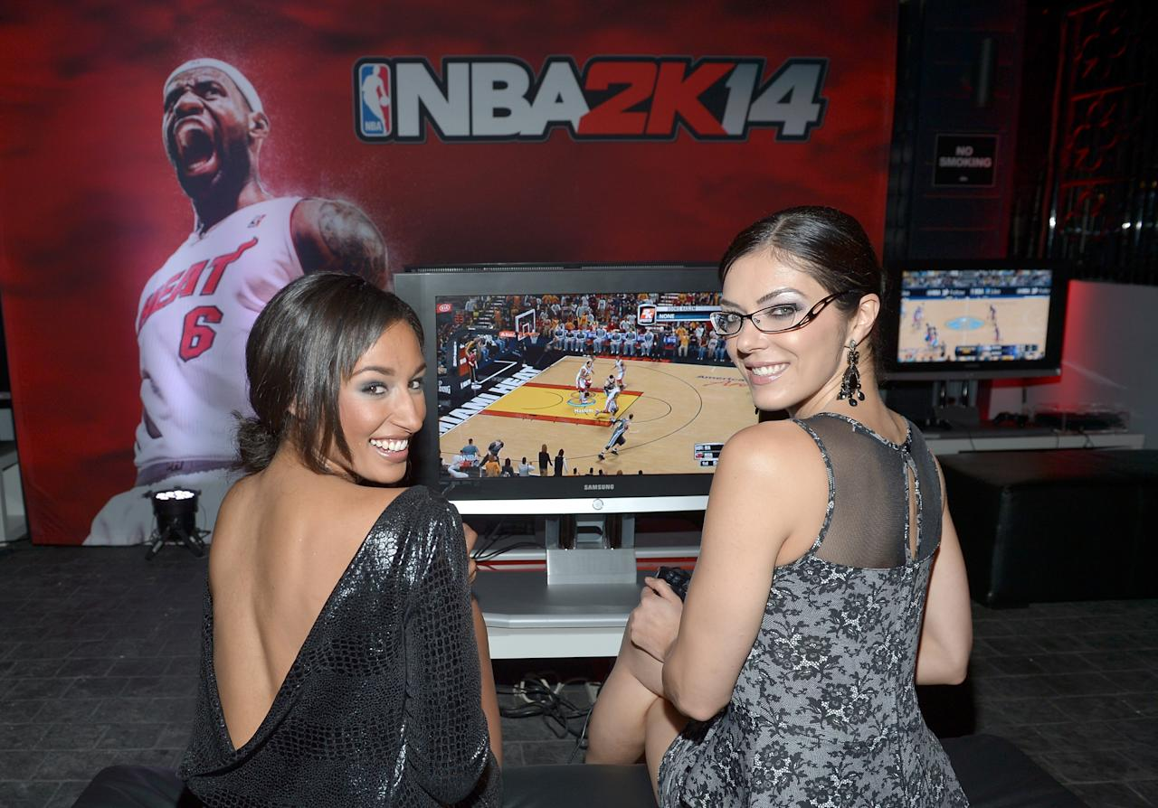 WEST HOLLYWOOD, CA - SEPTEMBER 24: Model Kiara Belen (L) and actress/producer Adrianne Curry attend the NBA 2K14 premiere party at Greystone Manor on September 24, 2013 in West Hollywood, California. (Photo by Charley Gallay/Getty Images for 2K)