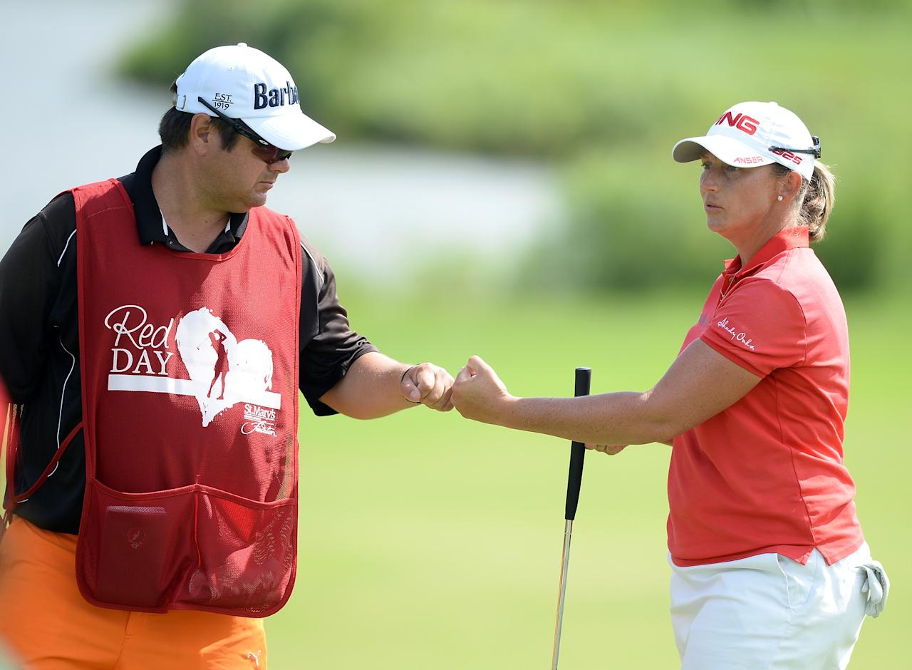 WATERLOO, CANADA - JULY 12: Angela Stanford and caddie Dan Chapman celebrate a birdie on the eighth green during round two of the Manulife Financial LPGA Classic at the Grey Silo Golf Course on July 12, 2013 in Waterloo, Canada. (Photo by Harry How/Getty Images)