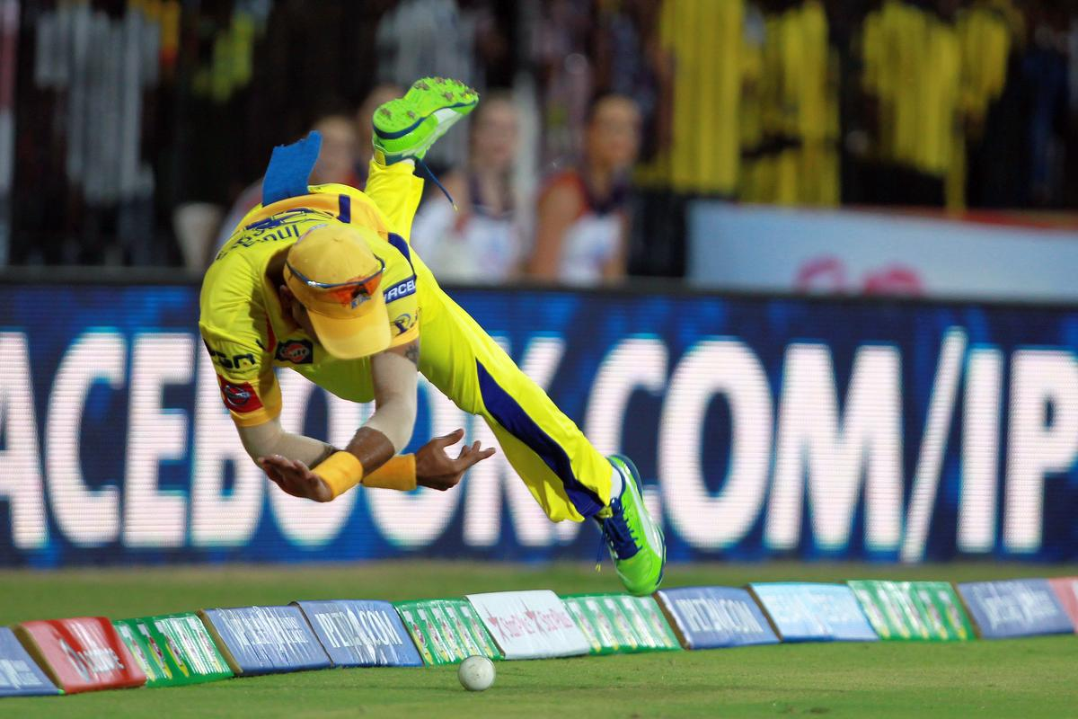 Subramaniam Badrinath dives to save a certain boundary during match 16 of the Pepsi Indian Premier League between The Chennai Superkings and the Royal Challengers Bangalore held at the MA Chidambaram Stadiumin Chennai on the 13th April 2013. Photo by Jacques Rossouw-IPL-SPORTZPICS   .. .Use of this image is subject to the terms and conditions as outlined by the BCCI. These terms can be found by following this link:..http://www.sportzpics.co.za/image/I0000SoRagM2cIEc