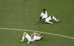 United States' Geoff Cameron, left, and Julian Green sit on the pitch after the loss to Belgium. (AP)
