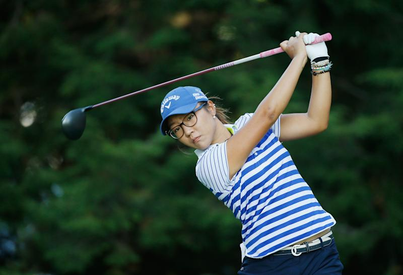 Lydia Ko of New Zealand hits a shot at the Wegmans LPGA Championship on August 17, 2014 in Pittsford, New York