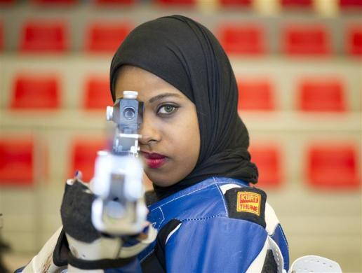 Kuwaiti Shooter Mariam Erzouqi, 24, poses as she takes aim during practice at the Kuwait Sheikh Sabah Al-Ahmad Olympic Shooting Complex in Kuwait, May 26, 2012. Mariam Erzouqi grips her German-made air rifle with carefully-manicured hands, steadies her footing, eyes the target and slowly pulls the trigger until a soft crack echoes through Kuwait's cavernous shooting range. The 24-year-old is set to become the second Kuwaiti woman to compete at an Olympic Games and will take dead aim at a medal in the 10 and 50 meters air rifle in London.