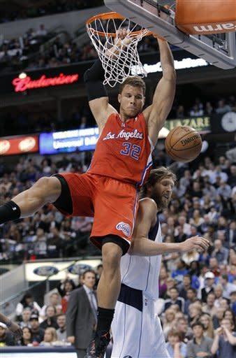 Los Angeles Clippers forward Blake Griffin (32) dunks over Dallas Mavericks forward Dirk Nowitzki during the first half of an NBA basketball game, Tuesday, March 26, 2013, in Dallas. (AP Photo/Brandon Wade)