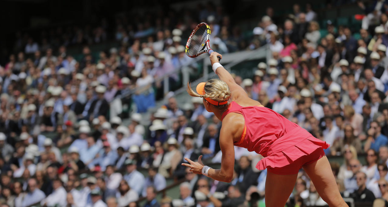 Canada's Eugenie Bouchard serves the ball during the semifinal match of the French Open tennis tournament against Russia's Maria Sharapova at the Roland Garros stadium, in Paris, France, Thursday, June 5, 2014.(AP Photo/Michel Spingler)