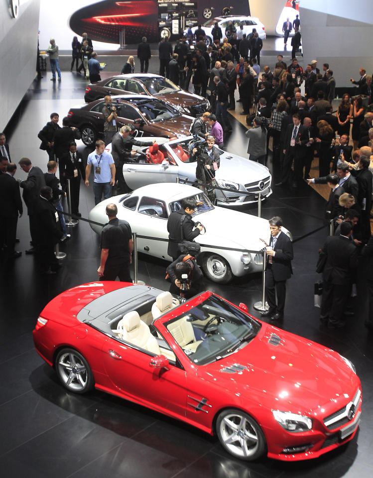 <p>               The 2013 Mercedes-Benz SL, foreground, is shown on the floor of the North American International Auto Show in Detroit, Monday, Jan. 9, 2012. (AP Photo/Carlos Osorio)