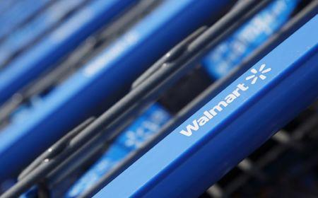 Shopping carts are seen outside a new Wal Mart Express store in Chicago