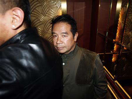 Birmingham City owner Carson Yeung stands in the lift after leaving in the middle of a general meeting at a hotel in Hong Kong