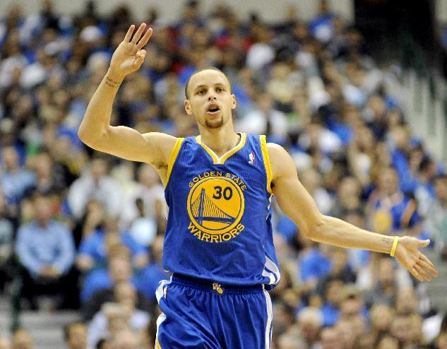 Golden State Warriors guard Stephen Curry (30) runs downcourt after making a shot in the second half of an NBA basketball game against the Dallas Mavericks, Tuesday, April 1, 2014, in Dallas. Golden State won 122-120 in overtime