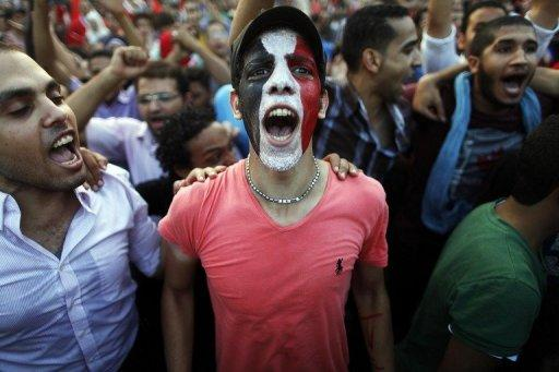 """Egyptians shout slogans against President Mohamed Morsi and the Muslim Brotherhood during a demonstration in Cairo, on July 1, 2013. Egypt's main opposition coalition says it would not support a """"military coup"""" and trusted that an army statement giving political leaders 48 hours to resolve the current crisis did not mean it would assume a political role"""