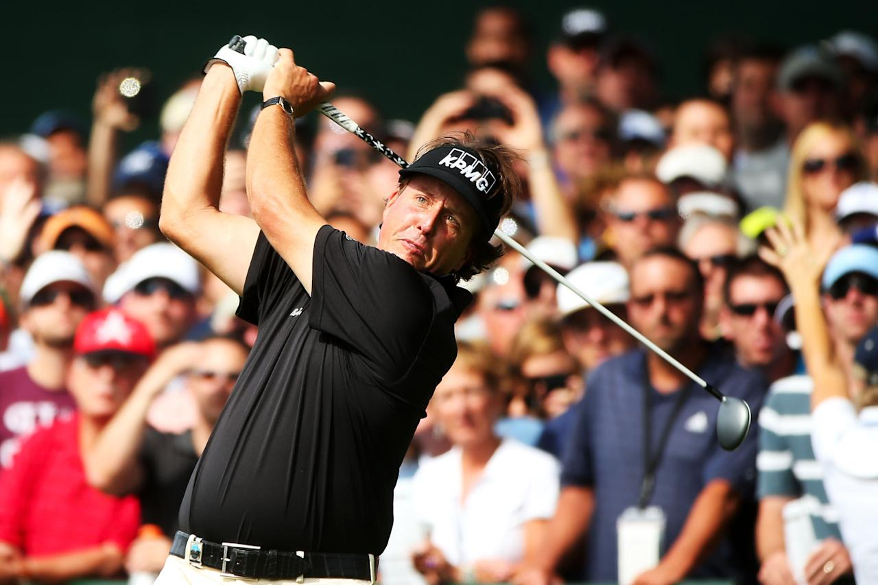 ROCHESTER, NY - AUGUST 10: Phil Mickelson of the United States hits his tee shot on the first hole during the third round of the 95th PGA Championship on August 10, 2013 in Rochester, New York. (Photo by Andrew Redington/Getty Images)