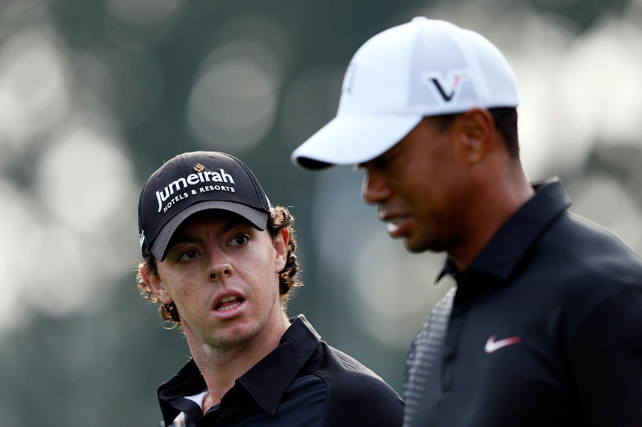 FARMINGDALE, NY - AUGUST 23:  (L-R) Rory McIlroy of Northern Ireland and Tiger Woods talk as they walk down the 10th hole during the First Round of The Barclays on the Black Course at Bethpage State Park August 23, 2012 in Farmingdale, New York.  (Photo by Kevin C. Cox/Getty Images)