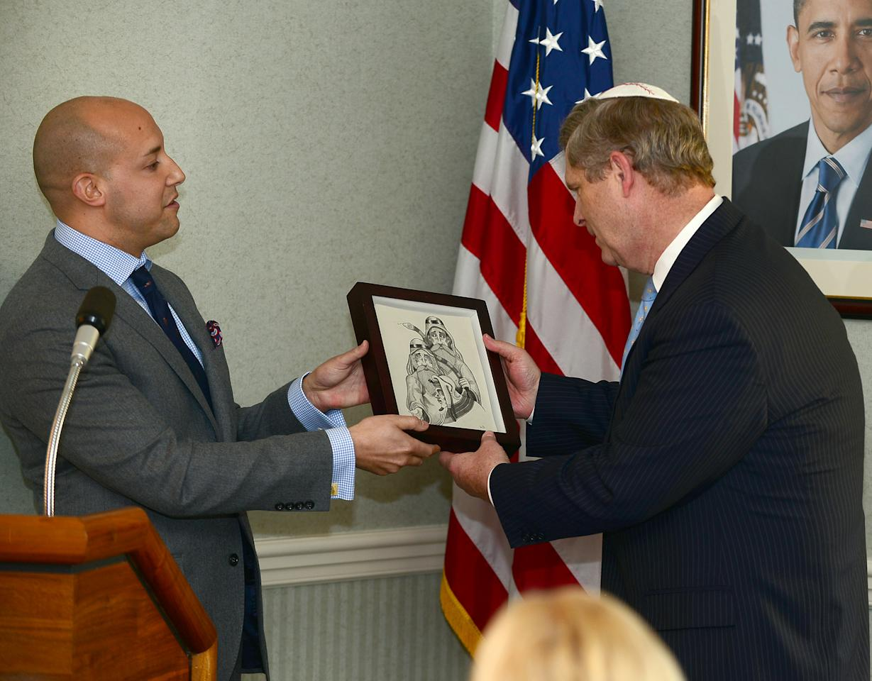 WASHINGTON, DC - APRIL 4:  In this handout photograph provided by Rabinowitz/Dorf, Alan van Capelle, Alan van Capelle, Chief Executive Officer, Bend the Arc: A Jewish Partnership for Justice (L), presents an award to U.S. Secretary of Agriculture Tom Vilsack at a mock Passover seder meal held at the US Department of Agriculture headquarters on April 4, 2012 in Washington, D.C.  The second annual Food and Justice Seder, co-hosted by Bend the Arc: A Jewish Partnership for Justice and The White House co-sponsored by Empire Kosher. The seder focused on the place where food, history, values and culture intersect and explored hunger and food access, labor conditions for food workers, environmentally sustainable production and consumption, and individual and communal responsibilities.  Passover formally begins Friday night. (Photo by Ron Sachs/Rabinowitz-Dorf Communications via Getty Images)