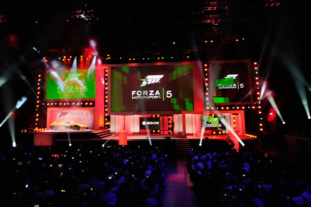 LOS ANGELES, CA - JUNE 10: A McLaren sports car is unveiled during the announcement of a new video game Forza Motorsport 5 during Microsoft Xbox news conference at the Electronic Entertainment Expo at the Galen Center on June 10, 2013 in Los Angeles, California. Thousands are expected to attend the annual three-day convention to see the latest games and announcements from the gaming industry. (Photo by Kevork Djansezian/Getty Images)