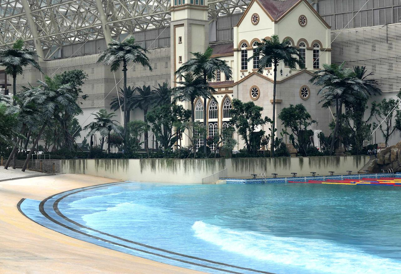 "A water park is seen in the ""New Century Global Centre"" building which opens to the public in Chengdu, southwest China's Sichuan province on June 28, 2013.  The center, claimed by Chinese officials to be ""the world's largest standalone structure"", measuring 500 metres in length and 400 metres in width, with 1.7 million square metres of floor space -- big enough to hold 20 Sydney Opera Houses -- is the latest symbol of China's economic boom.       CHINA OUT           AFP PHOTO"