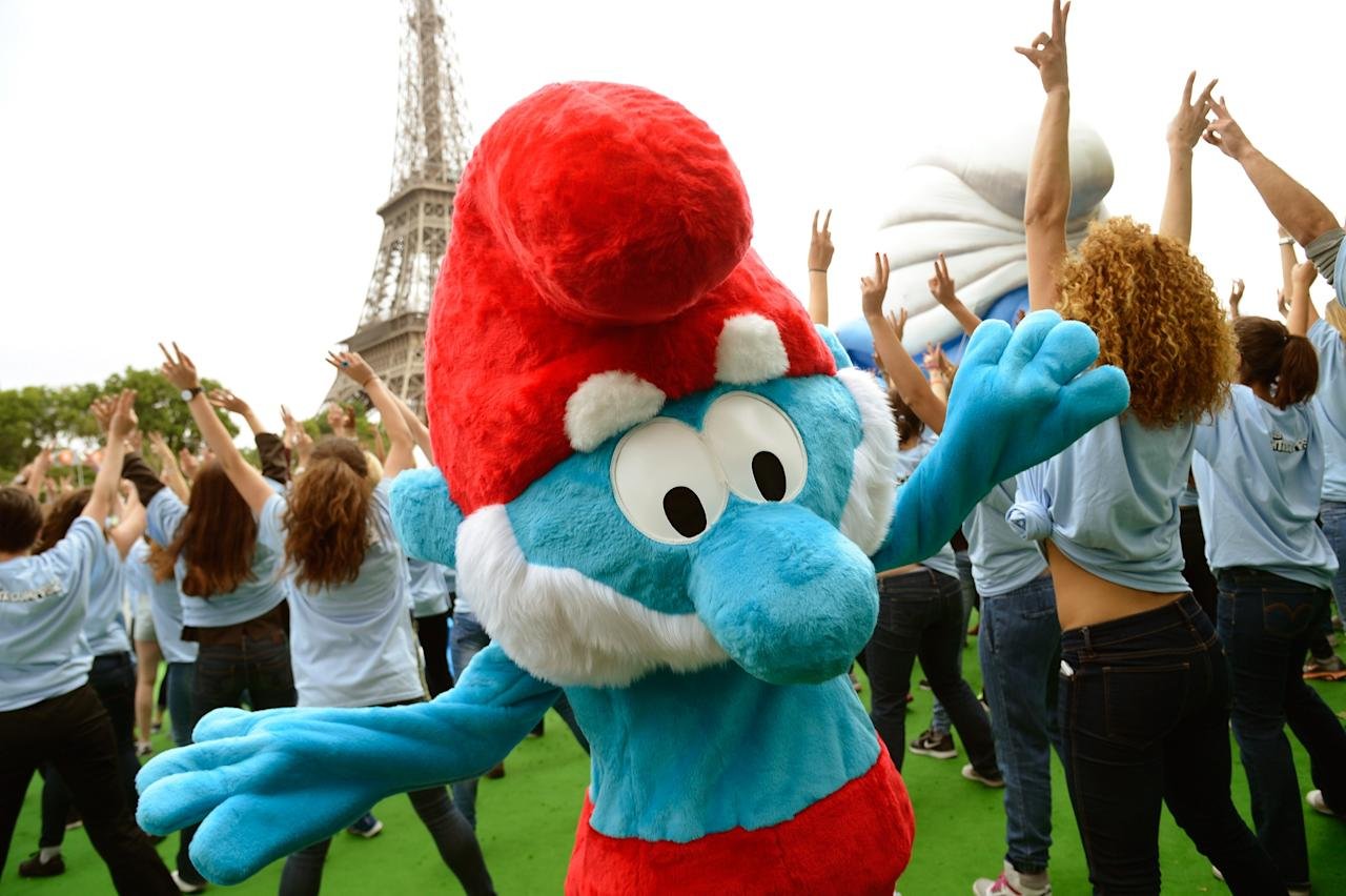 "PARIS, FRANCE - JUNE 22: A performer dressed as the Smurf character ""Papa Smurf"" takes part to a dance with performers as part of Global Smurfs Day celebrations on June 22, 2013 on the Seine river bank in Paris, France. (Photo by Pascal Le Segretain/Getty Images for Sony Pictures Entertainment)"