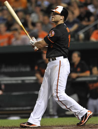 Baltimore Orioles' Chris Davis follows through on a solo home run against the New York Yankees in the second inning of a baseball game, Sunday, June 30, 2013, in Baltimore. (AP Photo/Gail Burton)