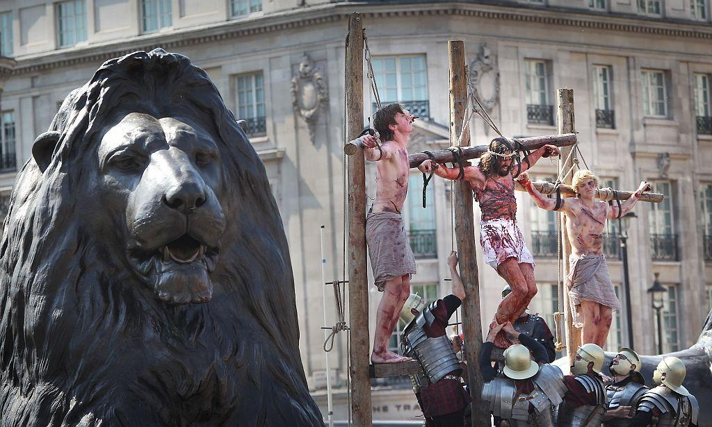 Actors perform The Passion of Jesus to crowds in Trafalgar Square in 2011 in London, England. The actors come from the Wintershall Estate in Surrey where they also perform a Nativity play in and around the farm buildings at Christmas.