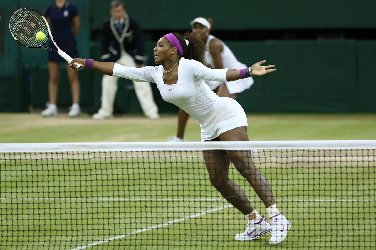 LONDON, ENGLAND - JULY 07:  Serena Williams of the USA hits a volley during their Ladies? Doubles final match against Andrea Hlavackova and Lucie Hradecka of the Czech Republic on day twelve of the Wimbledon Lawn Tennis Championships at the All England Lawn Tennis and Croquet Club on July 7, 2012 in London, England.  (Photo by Julian Finney/Getty Images)