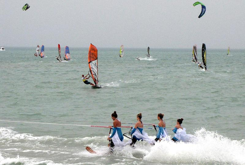 Competitors in the windsurfing World Cup sailing at Turkmenistan's new Caspian Sea resort of Avaza on July 1, 2014