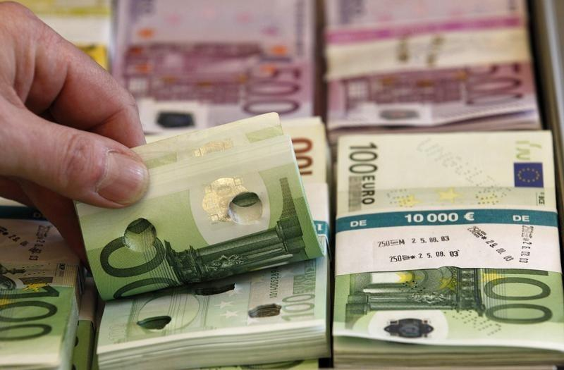 Punctured euro banknotes used for training purposes are presented during news conference on German custom's annual statistics in Berlin