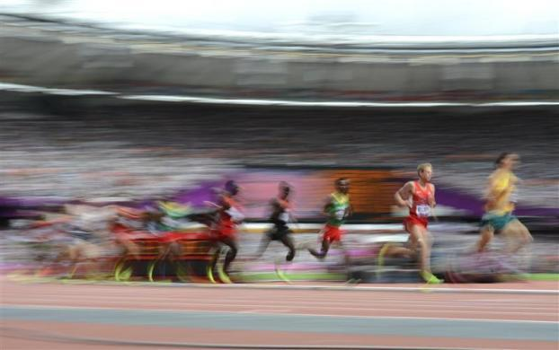 Galen Rupp (2nd R) of the U.S. runs with other competitors in their men's 5000m round 1 heat at the London 2012 Olympic Games at the Olympic Stadium August 8, 2012.