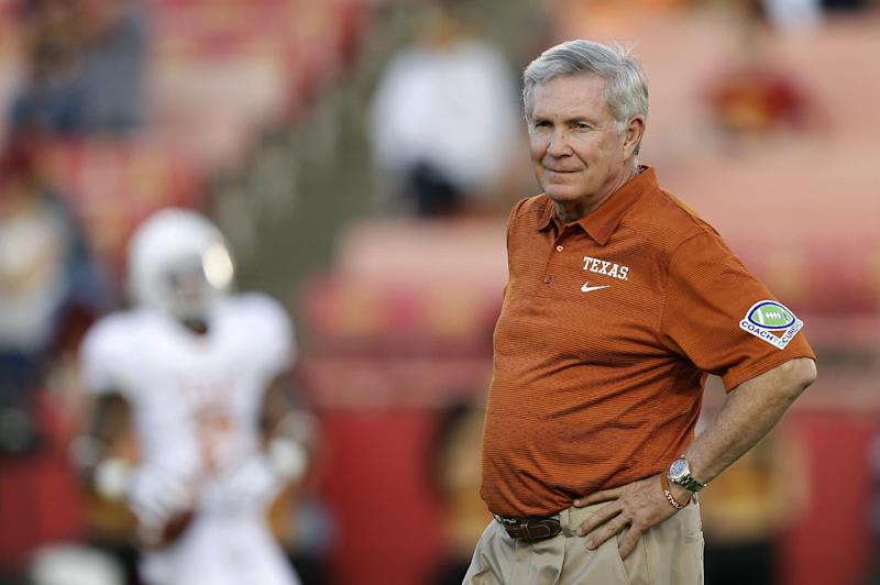"ZThis is an Oct. 3, 2013 file photo showing University of Texas football head coach Mack Brown watching his team warm up before an NCAA college football game against Iowa State, in Ames, Iowa. Former Texas coach Brown will serve as a studio analyst for college football games on ABC. Brown stepped down in December after 16 years with the Longhorns, winning the national title after the 2005 season. Brown will appear on ""College Football Countdown"" and offer pregame, halftime and postgame commentary for the games on ABC, including ""Saturday Night Football."""