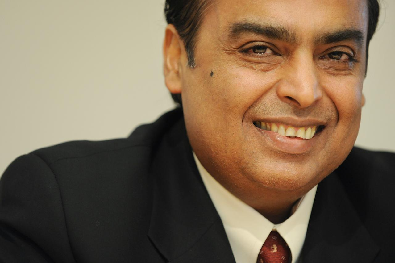Mukesh Ambani, Chairman and Managing Director of Reliance Industries Limited, smiles as he attends a press conference with BP Chairman, Carl-Henric Svanberg and BP Chief Executive Bob Dudley (both not pictured) in central London, on February 21, 2011. British energy giant BP said Monday that it will pay $7.2 billion (5.3 billion euros) to Mumbai-based Reliance Industries for a 30-percent stake in 23 Indian oil and gas blocks. AFP PHOTO/BEN STANSALL