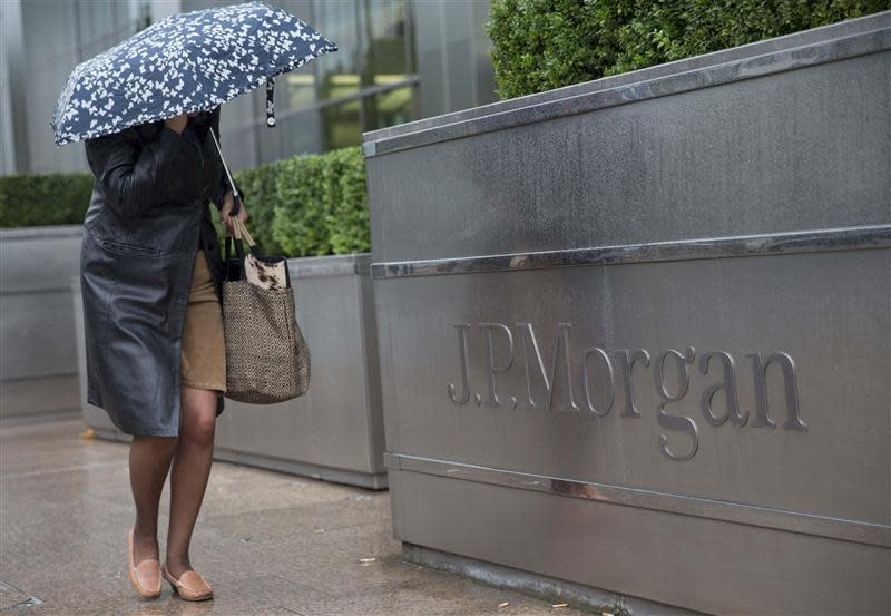 A pedestrian walks past the Canary Wharf offices of JP Morgan in London