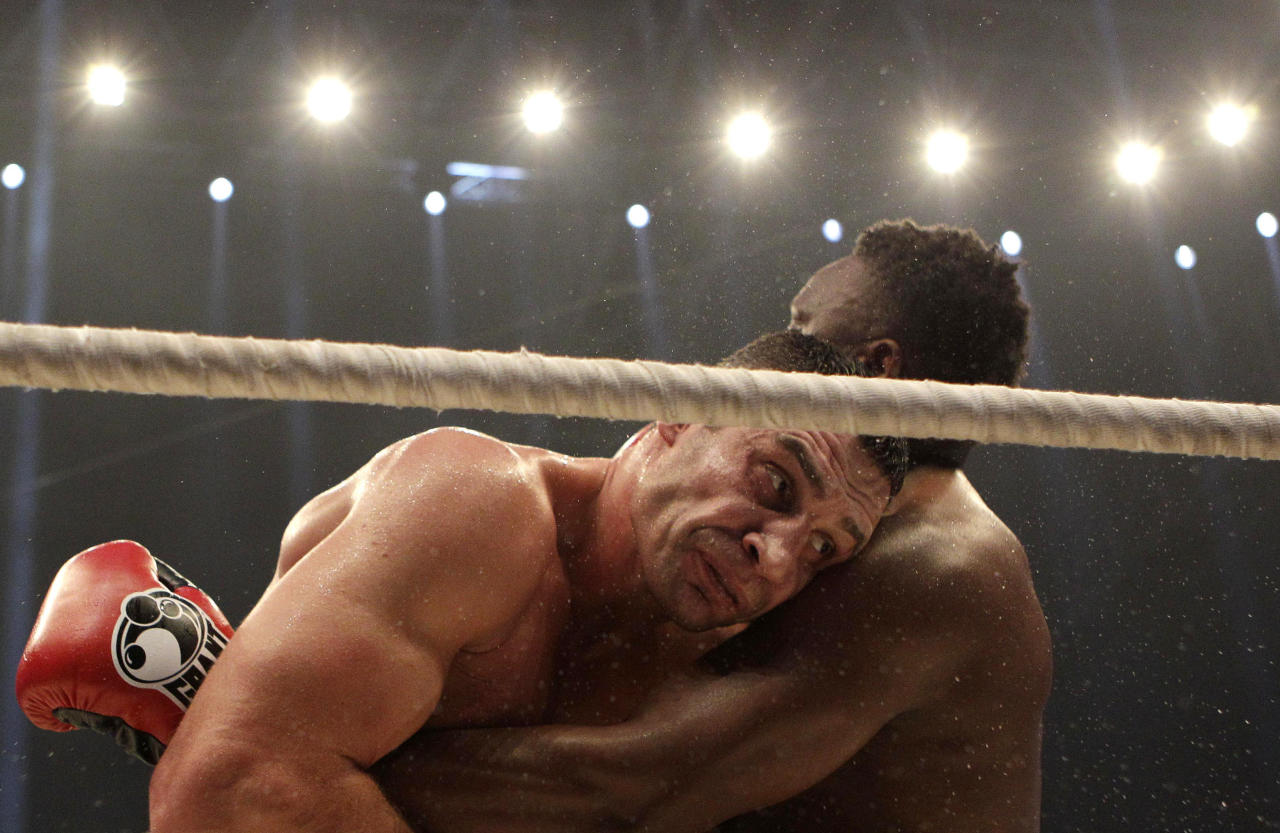 WBC heavyweight Champion Vitali Klitschko of Ukraine, left, fights with challenger Dereck Chisora of Britain during their WBC heavyweight title boxing bout at the Olympic hall in Munich, Germany , Saturday, Feb. 18, 2012. (AP Photo/Frank Augstein)