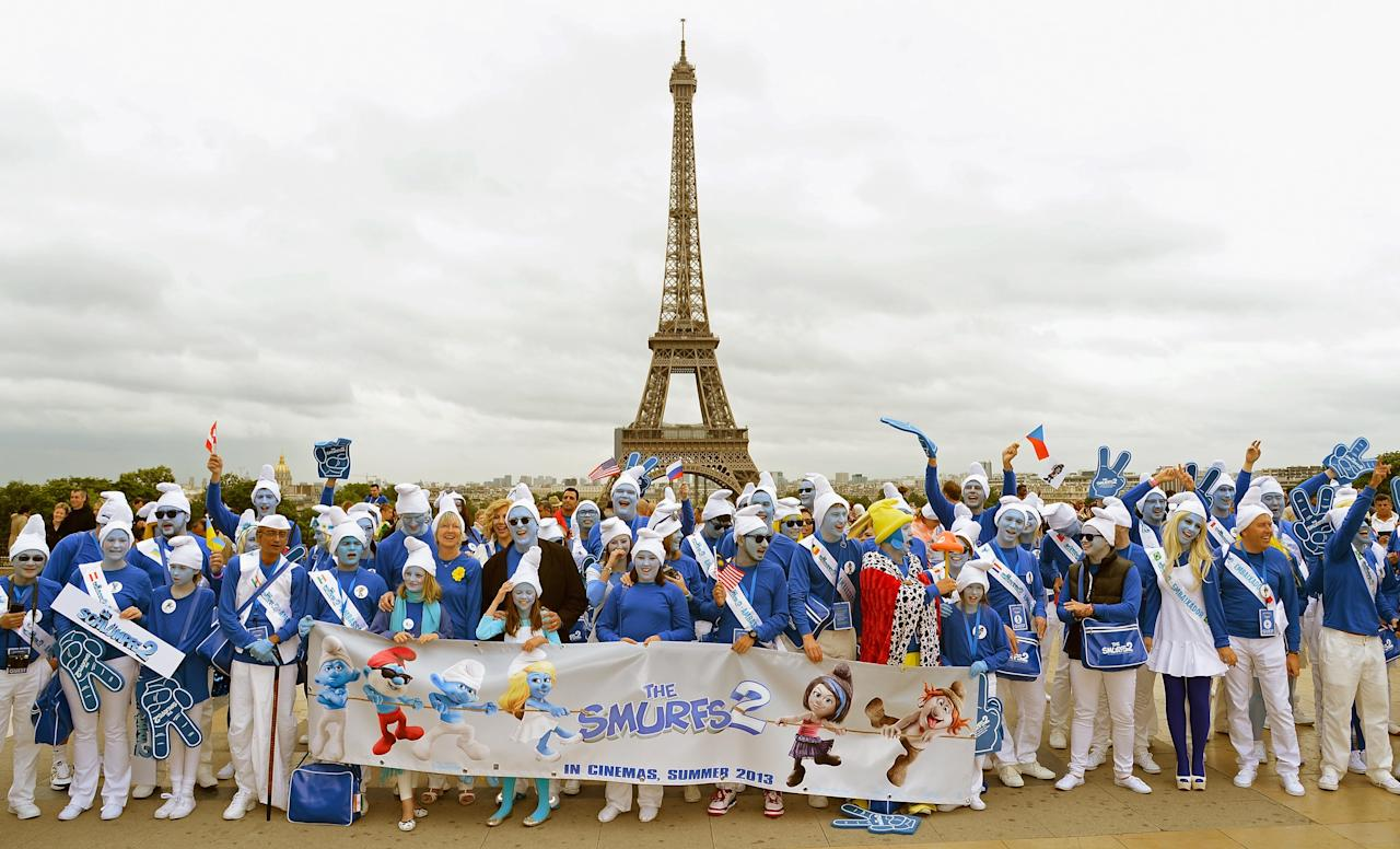 PARIS, FRANCE - JUNE 22: (From 7th L)Veronique Culliford, the daughter of late cartoonist Peyo, the creator of The Smurfs, and producer Jordan Kerner, and Smurf Ambassadors pose for a group photo on the Trocadero plaza as part of Global Smurfs Day celebrations on June 22, 2013 in Paris, France. The Eiffel tower is seen behind. (Photo by Pascal Le Segretain/Getty Images for Sony Pictures Entertainment)