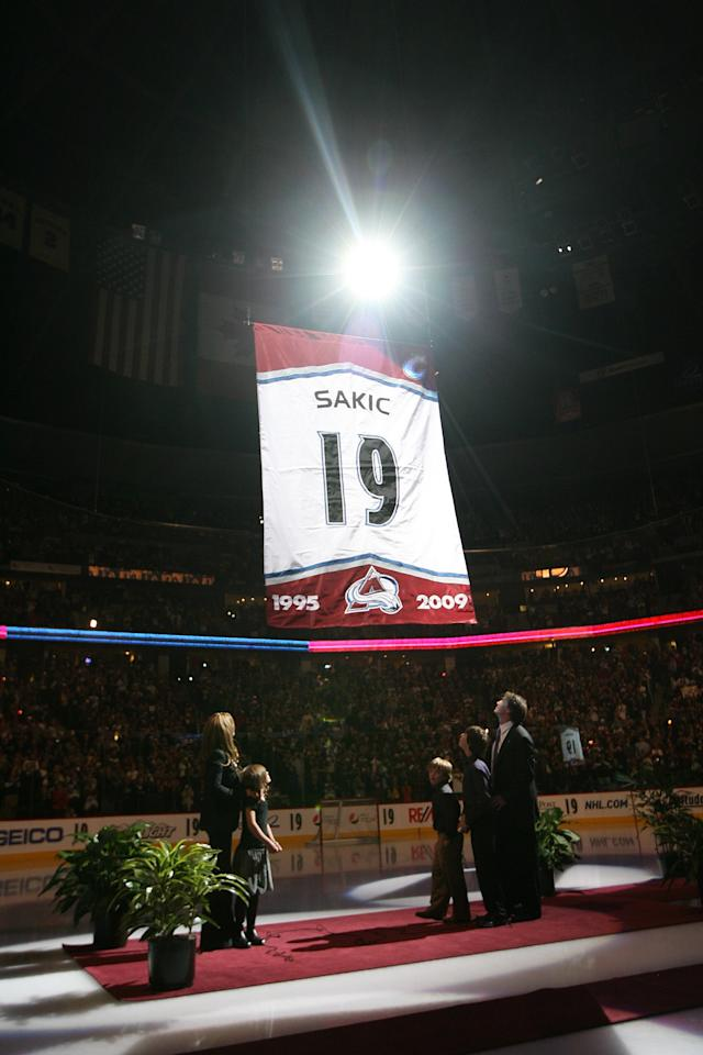 DENVER - OCTOBER 1: Former Colorado Avalanche player Joe Sakic and his family watch as his number banner is raised to the rafters during his number retirement ceremony before the Avalanche home season opening game against the San Jose Sharks at the Pepsi Center on October 1, 2009 in Denver, Colorado. (Photo by Michael Martin/NHLI via Getty Images)