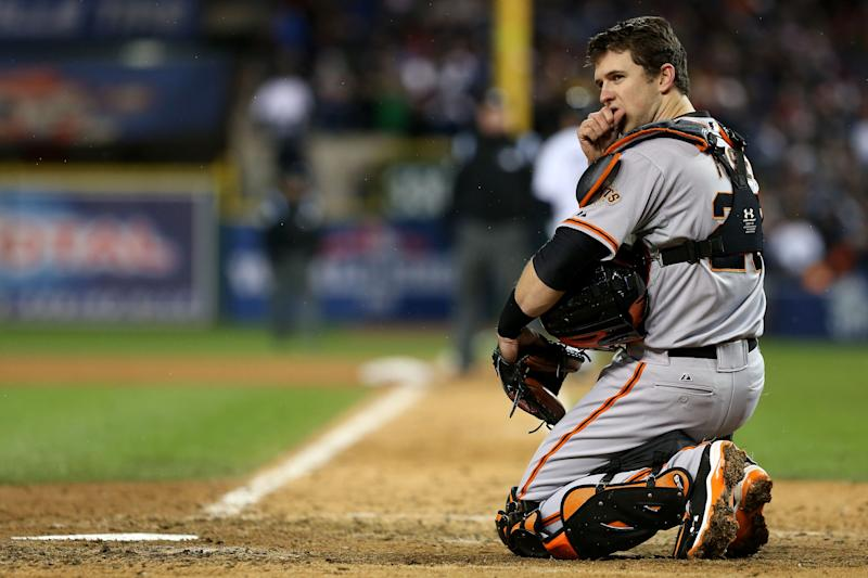DETROIT, MI - OCTOBER 28:  Buster Posey #28 of the San Francisco Giants warms his hands in the ninth inning against the Detroit Tigers during Game Four of the Major League Baseball World Series at Comerica Park on October 28, 2012 in Detroit, Michigan.  (Photo by Ezra Shaw/Getty Images)