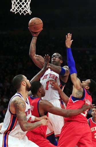 New York Knicks' Amare Stoudemire (1) shoots over Philadelphia 76ers' Andre Iguodala during the first half of an NBA basketball game Wednesday, Jan. 11, 2012, in New York. (AP Photo/Frank Franklin II)
