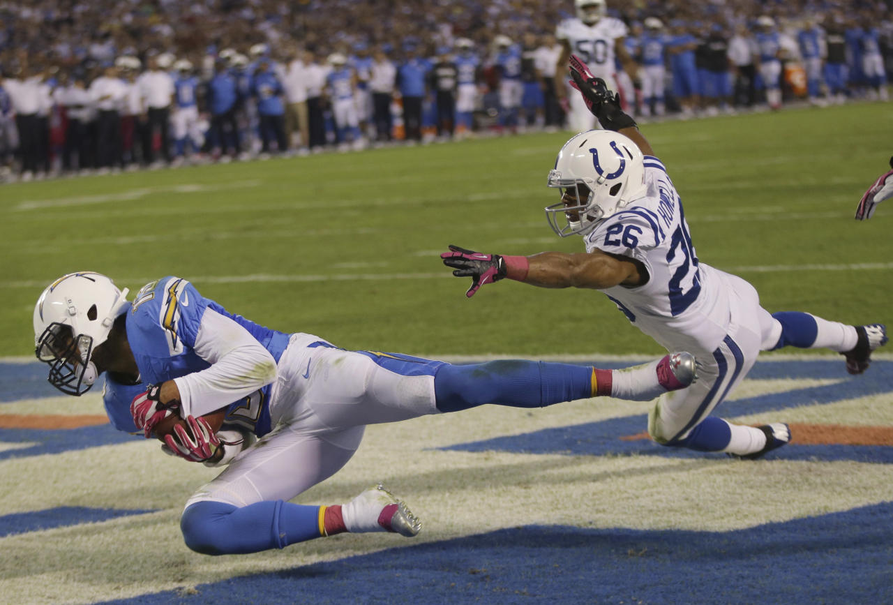 San Diego Chargers wide receiver Keenan Allen, left, makes a touchdown catch in the end zone as Indianapolis Colts free safety Delano Howell, right, defends during the first half of an NFL football game Monday, Oct. 14, 2013, in San Diego. (AP Photo/Lenny Ignelzi)