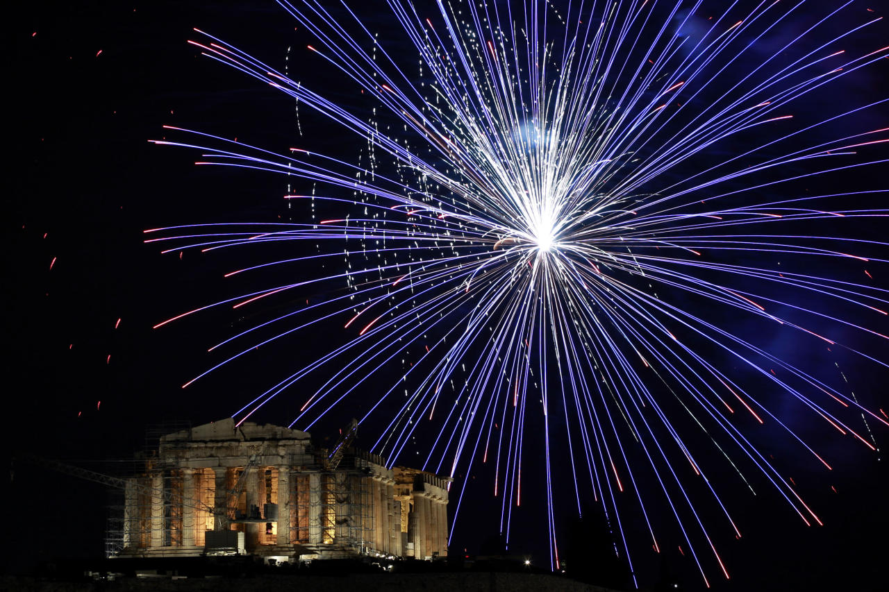 Fireworks explode over the ancient Parthenon temple at the Acropolis Hill during the New Year's celebrations in Athens, on Tuesday Jan. 1, 2013. (AP Photo/Petros Giannakouris)