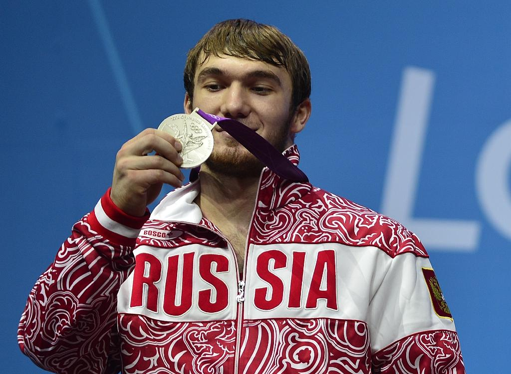 Russia's Apti Aukhadov, pictured on the podium of the men's 85kg weightlifting event at the 2012 Olympic Games, was stripped of his silver medal by the IOC after a sample re-test came back positive for drugs (AFP Photo/Yuri Cortez)