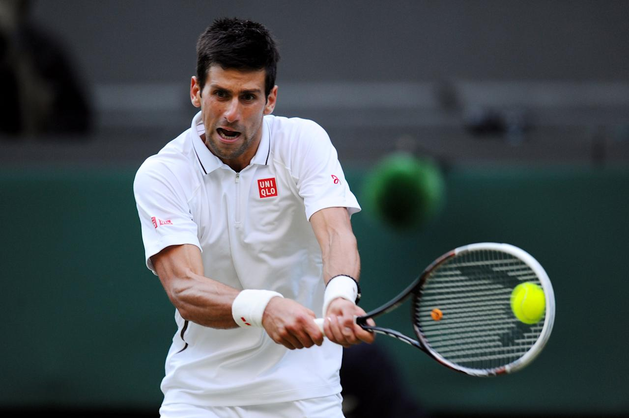 LONDON, ENGLAND - JULY 01: Novak Djokovic of Serbia plays a backhand during the Gentlemen's Singles fourth round match against Tommy Haas of Germany on day seven of the Wimbledon Lawn Tennis Championships at the All England Lawn Tennis and Croquet Club on July 1, 2013 in London, England. (Photo by Mike Hewitt/Getty Images)