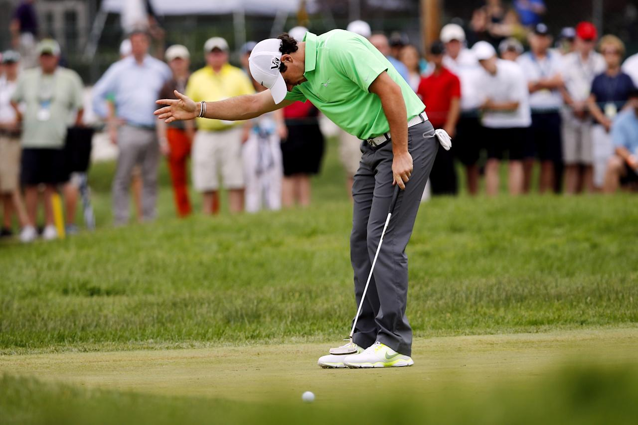 ARDMORE, PA - JUNE 16: Rory McIlroy of Northern Ireland reacts to his putt on the fourth green during the final round of the 113th U.S. Open at Merion Golf Club on June 16, 2013 in Ardmore, Pennsylvania. (Photo by Rob Carr/Getty Images)