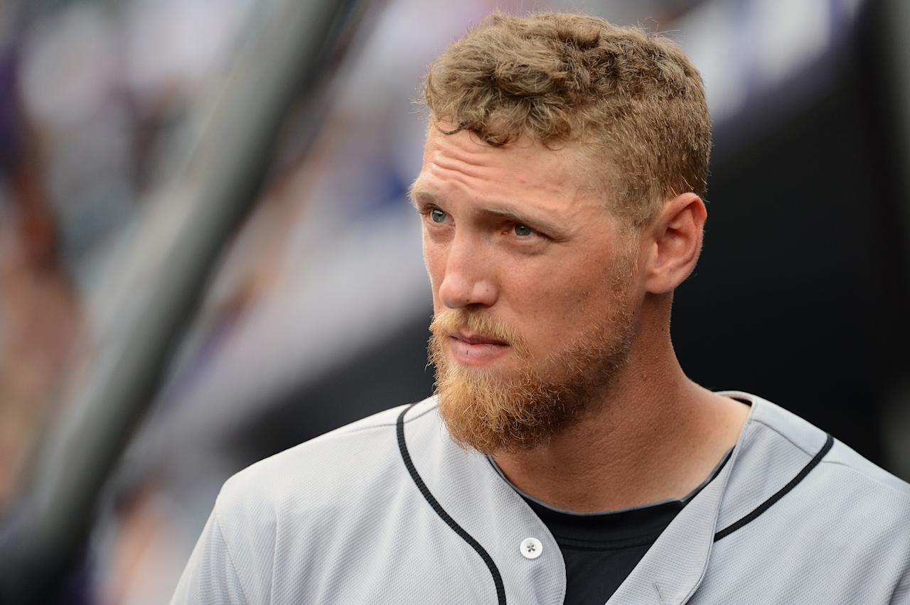 DENVER, CO - JUNE 30: Hunter Pence #8 of the San Francisco Giants watches the game against the Colorado Rockies from the dug out at Coors Field on June 30, 2013 in Denver, Colorado. (Photo by Garrett W. Ellwood/Getty Images)