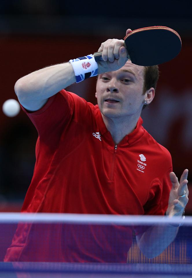 LONDON, ENGLAND - JULY 29:  Paul Drinkhall of Great Britain plays a forehand in his Men's Singles second round match against Zi Yang of Singapore on Day 2 of the London 2012 Olympic Games at ExCeL on July 29, 2012 in London, England.  (Photo by Feng Li/Getty Images)