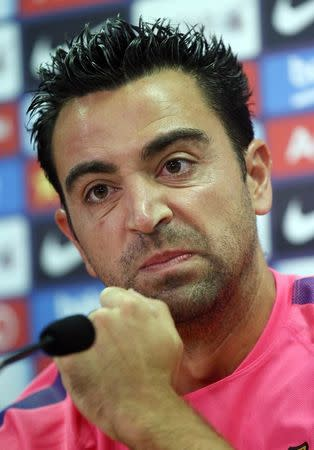 FC Barcelona's player Xavi Hernandez gestures during a news conference at Joan Gamper training camp