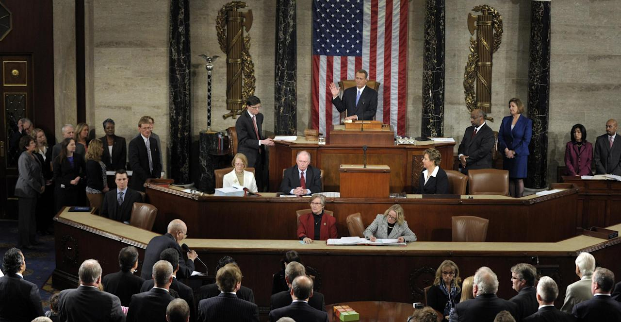 House Speaker John Boehner of Ohio is sworn in by Dean of the House, Rep . John Dingell , D-Mich., lower left, as the Speaker of the House of the 113th Congress, Thursday, Jan. 3, 2013, on Capitol Hill in Washington. (AP Photo/Susan Walsh)