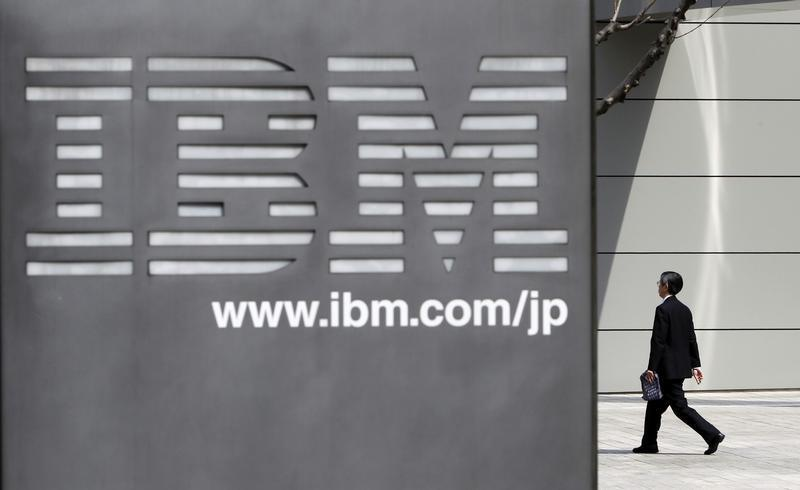 A man walks past the headquarters of IBM Japan in Tokyo