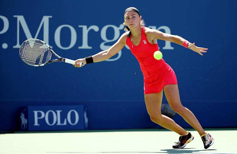 Aleksandra Krunic of Serbia returns a shot against Petra Kvitova of the Czech Republic during their women's singles third round match at the 2014 US Open on August 30, 2014 in New York