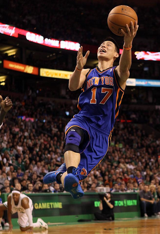 BOSTON, MA - MARCH 04:  Jeremy Lin #17 of the New York Knicks heads for the net as Paul Pierce #34 of the Boston Celtics is down on March 4, 2012 at TD Garden in Boston, Massachusetts. The Boston Celtics defeated the New York Knicks 115-111 in overtime. NOTE TO USER: User expressly acknowledges and agrees that, by downloading and or using this photograph, User is consenting to the terms and conditions of the Getty Images License Agreement.  (Photo by Elsa/Getty Images)