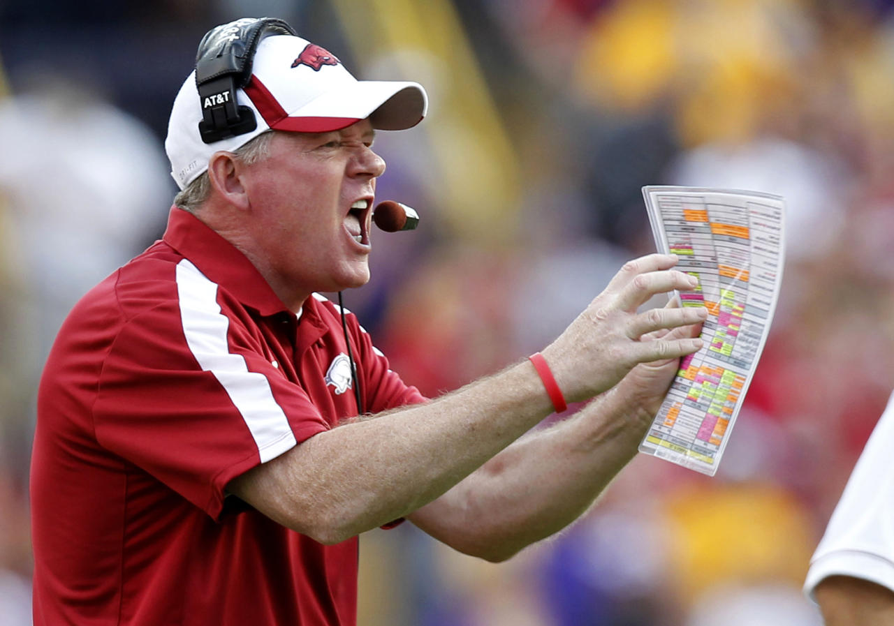 Arkansas head coach Bobby Petrino calls out to his team during the second quarter of an NCAA college football game against LSU in Baton Rouge, La., Friday, Nov. 25, 2011. (AP Photo/Gerald Herbert)