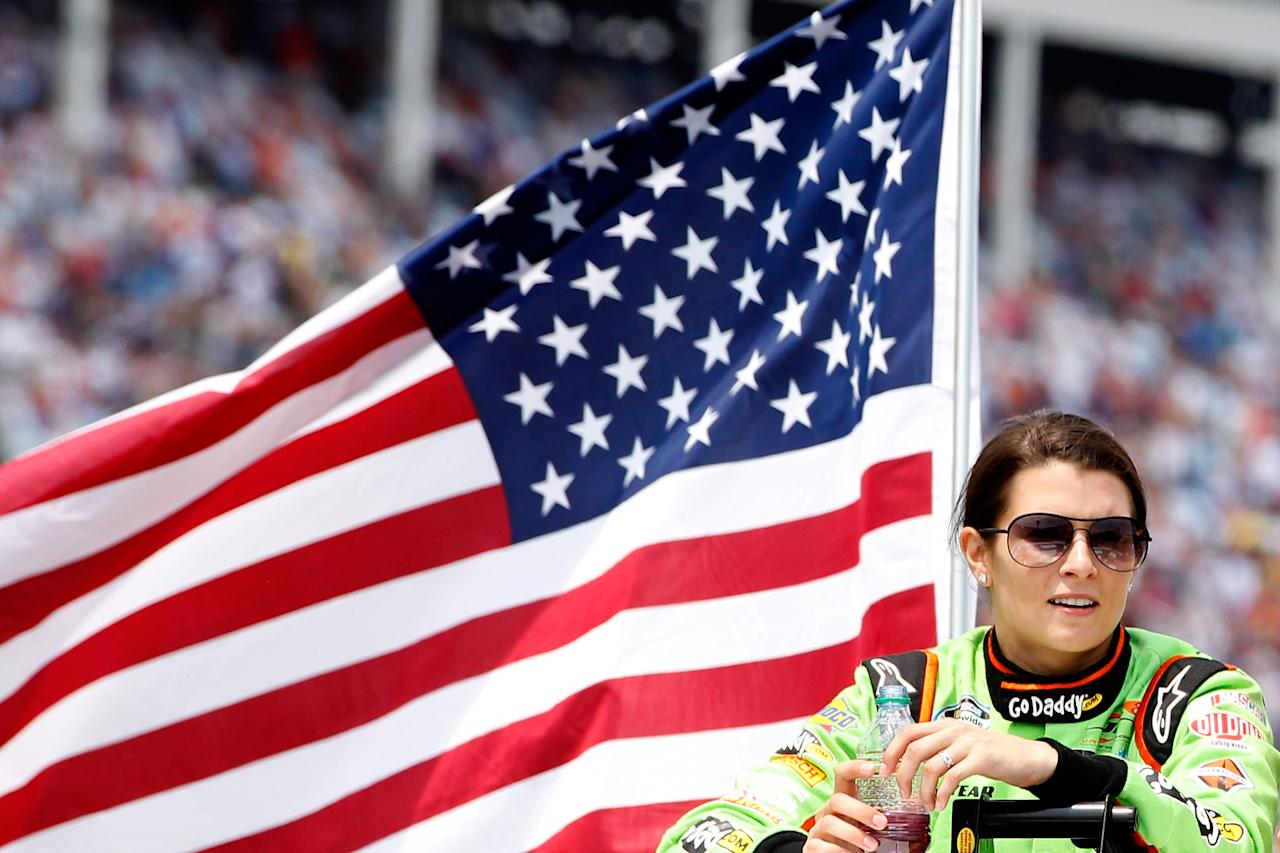 CONCORD, NC - MAY 26:  Danica Patrick, driver of the #7 GoDaddy.com Chevrolet, looks on from a truck during driver introductions prior to the NASCAR Nationwide Series History 300 at Charlotte Motor Speedway on May 26, 2012 in Concord, North Carolina.  (Photo by Tyler Barrick/Getty Images for NASCAR)