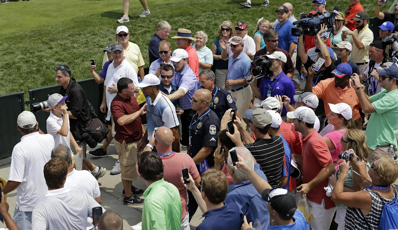 Tiger Woods walks to the first tee for a practice round for the PGA Championship golf tournament at Valhalla Golf Club on Wednesday, Aug. 6, 2014, in Louisville, Ky. The tournament is set to begin on Thursday. (AP Photo/Jeff Roberson)