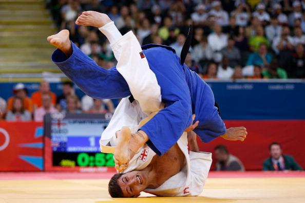 LONDON, ENGLAND - AUGUST 01:  Mark Anthony of Australia (blue) competes with Varlam Liparteliani of Georgia during the Men's -90 kg Judo on Day 5 of the London 2012 Olympic Games at ExCeL on August 1, 2012 in London, England.  (Photo by Jamie Squire/Getty Images)