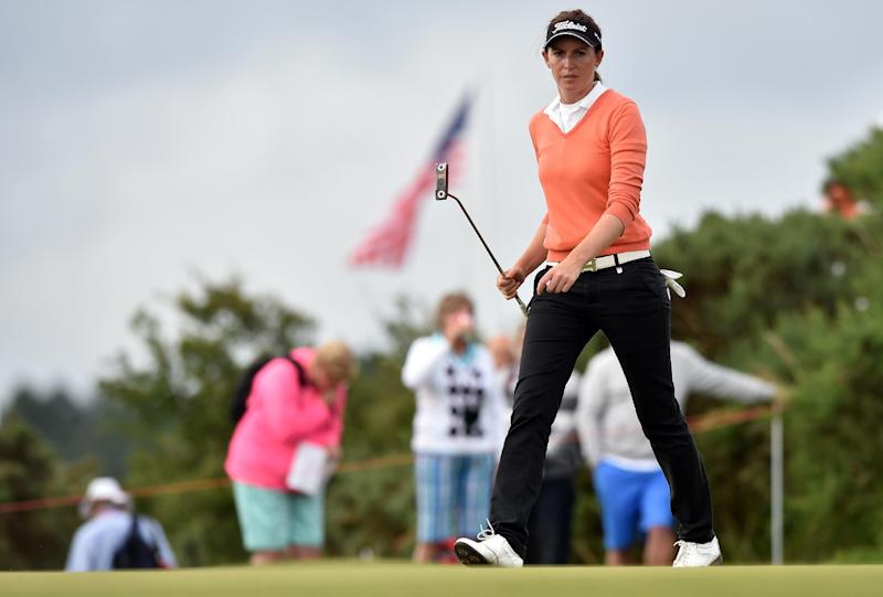 Australia's Karrie Webb walks towards the 9th green at the Royal Birkdale golf course in Southport, north-west England, on July 10, 2014, during the first day of the Women's British Open